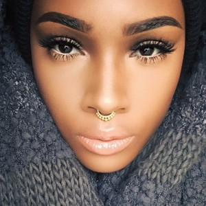 septum-piercing-with-gold-septum-ring