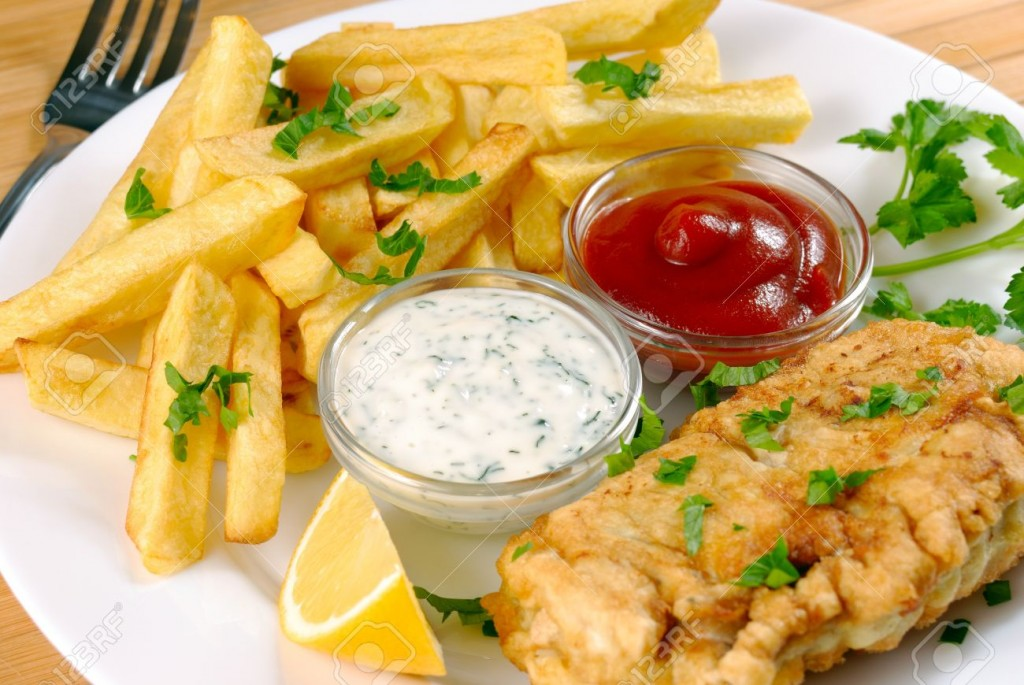 9157864-white-plate-with-fish-and-chips-mayo-lemon-and-ketchup-stock-photo
